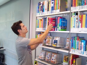 Student at a bookshelf in the learning centre